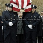 Margaret Falcone (center) follows the casket of her son, Poughkeepsie police officer John Falcone into St. James the Apostle Church prior to his funeral services in Carmel, NY on Thursday, February 24, 2011. Officer Falcone is the City of Poughkeepsie pol