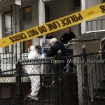 Newburgh Police Crime Scene Detectives and funeral home personnel remove the first of two bodies from 12 Liberty Street in the Heights neighborhood of the City of Newburgh, NY on Friday, November 5, 2010. Two men were the victims of a double homicide last