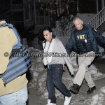 A suspected gang member (center) is taken into custody from his home at 45 Bayview Terrace in the City of Newburgh, NY, on Thursday, February 10, 2011. Multiple law enforcement agencies, including the FBI, Orange County Sheriff's Office, NY State Police,