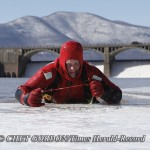 DEP Police officer Chuck Chapman uses hand ice picks to pull himself out of the frozen Ashokan Reservoir during an ice rescue training session by the DEP Police on the Ashokan Reservoir in Shokan, NY on Thursday, March 3, 2011.  CHET GORDON/Times Herald-R