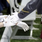 Cadets share handshakes as they make their way to the dais to receive their diplomas during the United States Military Academy's 2010 Graduation and Commissioning Ceremony at Michie Stadium in West Point, NY on Saturday, May 22, 2010. President Barack Oba