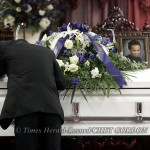 Yul Bookal collapses on the coffin bearing the body of his son Marc Anthony Bookal, during funeral services for the child at the House of Refuge in the City of Newburgh, NY on Saturday, April 24, 2010. Bookal is the four year-old Newburgh boy who went mis