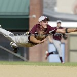 Livingston Manor shortstop Ken Fisk (#14) dives but can't make the play on a ball hit by Tim Steffens (#9) of Smithtown Christian during the fourth inning of their New York State Class D regional final at Pine Bush High School in Pine Bush, NY on Tuesday,