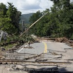 Bridge Street is littered with downed trees, power lines, and roadway damage after flooding from the Esopus Creek in Phoenicia, NY on Wednesday, August 31, 2011. The Hamlet of Phoenicia is still without power after Tropical Storm Irene passed through the