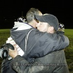 NFA head coach Bill Bianco (right) greets Monroe-Woodbury head coach Pat D'Aliso (left) after their Class AA football game in Central Valley, NY on Friday, October 14, 2011. NFA defeated Monroe-Woodbury 7 - 0 to end Monroe-Woodbury's 63-game winning strea