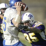 Washingtonville quarterback Chaynce Pelio (#15, left) is pressured by Warwick's J.J. Prell (#35) during their Section 9 Class AA Div II game against Washingtoville at Warwick High School in Warwick, NY on Saturday, October 22, 2011. Washingtonville defeat
