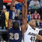 Navy's Carlton Smith (#20, left) misses a dunk over Army's Jordan Springer (#42, right) during the first half of their game in Christl Arena at the United States Military Academy in West Point, NY on Saturday, February 11, 2012. Springer had 4 points as A