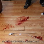 Blood stains and bullet holes in the floor inside 55 Liberty Street in Newburgh, NY on Thursday morning, March 8, 2012. Michael Lembhard (22) was shot and killed in a police involved shooting inside the residence late Wednesday night.  CHET GORDON/Times H