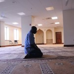 Abukar Cisse of New Windsor and originally from Senegal prays alone during the first day of Ramadan at the Masjid Al-Ikhlas mosque in Newburgh, NY on Friday, July 20, 2012. Ramadan is the ninth month in the Islamic calendar. It is a period of prayer, fast