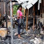 Sandria Lawrence pauses her father's apartment destroyed by fire at New Windsor Gardens apartment in New Windsor, NY on Wednesday, July 24, 2013. A kitchen fire in the apartment displaced eight families and injured three firefighters in the Monday afterno