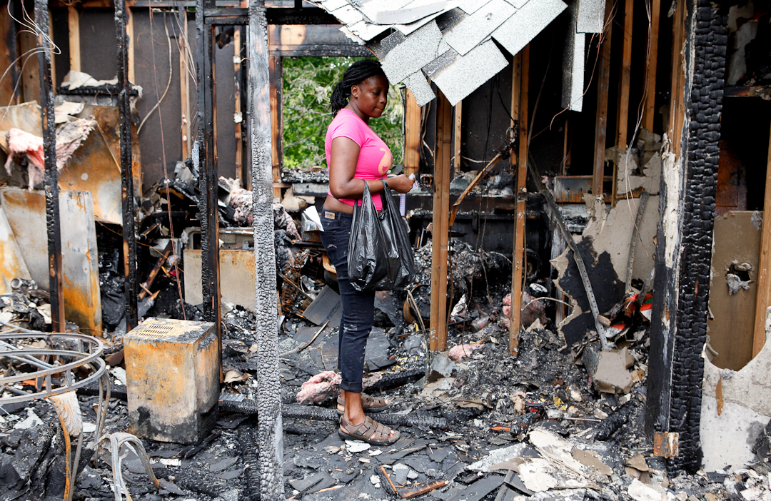 A Woman Pauses In Her Fatheru0027s Apartment Destroyed By Fire At New Windsor  Gardens ...